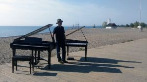 Two grand pianos on the beach
